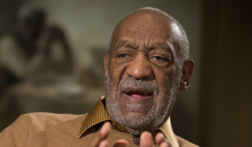 Entertainer Bill Cosby gestures during an interview at the Smithsonian's National Museum of African Art, in Washington, in this Nov. 6, 2014, file photo. (AP Photo/Evan Vucci, File)