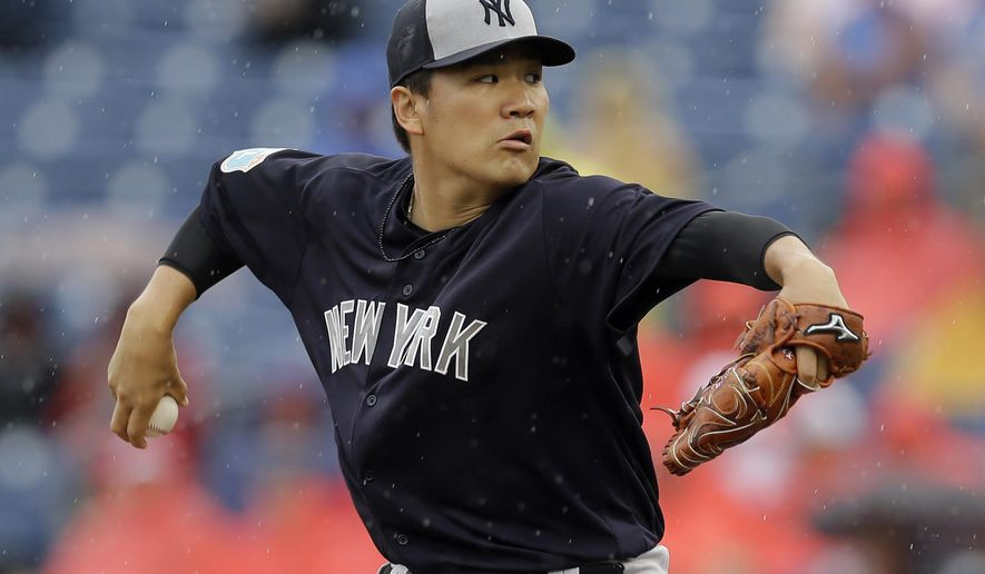 New York Yankees starting pitcher Masahiro Tanaka, of Japan, goes into his wind up against the Philadelphia Phillies during the first inning of a spring training baseball game Tuesday, March 29, 2016, in Clearwater, Fla. (AP Photo/Chris O'Meara)