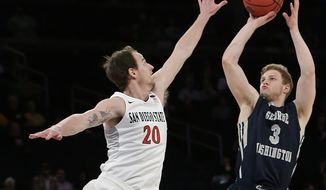 George Washington's Paul Jorgensen (3) shoots over San Diego State's Matt Shrigley (20) during the second half of an NCAA college basketball game in the semifinals of the NIT on Tuesday, March 29, 2016, in New York. George Washington won 65-46. (AP Photo/Frank Franklin II)