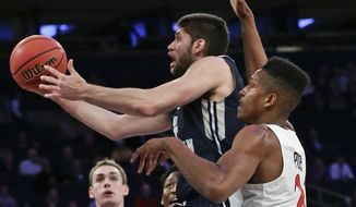 George Washington 's Patricio Garino (13) drives past San Diego State's Malik Pope (21) during the second half of an NCAA college basketball game in the semifinals of the NIT on Tuesday, March 29, 2016, in New York. George Washington won 65-46. (AP Photo/Frank Franklin II)