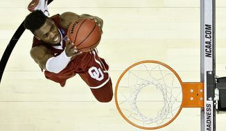 Oklahoma guard Buddy Hield scores against Oregon during the second half of an NCAA college basketball game in the regional finals of the NCAA Tournament, Saturday, March 26, 2016, in Anaheim, Calif. (AP Photo/Gregory Bull)