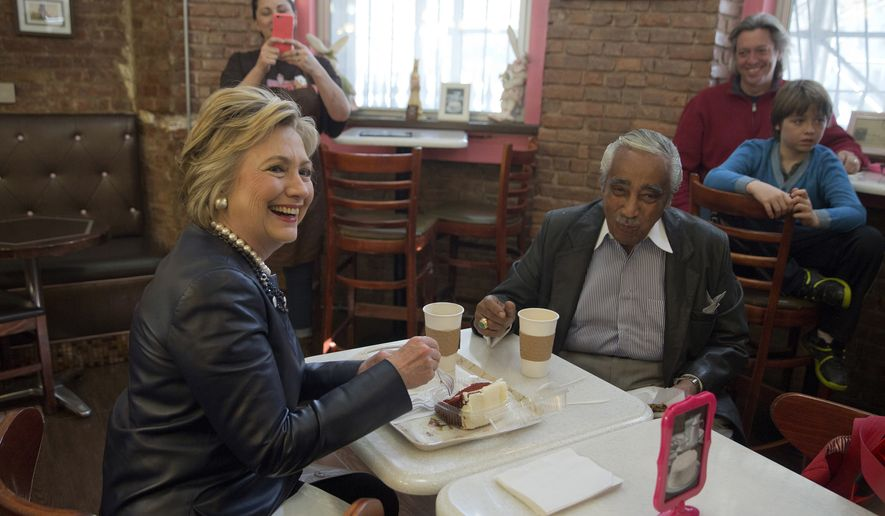 Democratic presidential candidate Hillary Clinton, and Rep, Charles Rangel, D-N.Y. meet over coffee and cake at Make My Cake Bakery, Wednesday, March 30, 2016, in the Harlem neighborhood of New York. (AP Photo/Mary Altaffer)