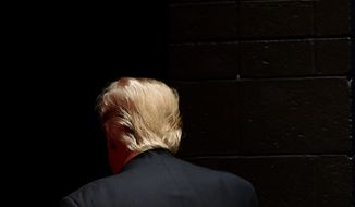 Republican presidential candidate Donald Trump walks off stage after speaking at a campaign event at St. Norbert College in De Pere, Wis., Wednesday, March 30, 2016. (AP Photo/Patrick Semansky)