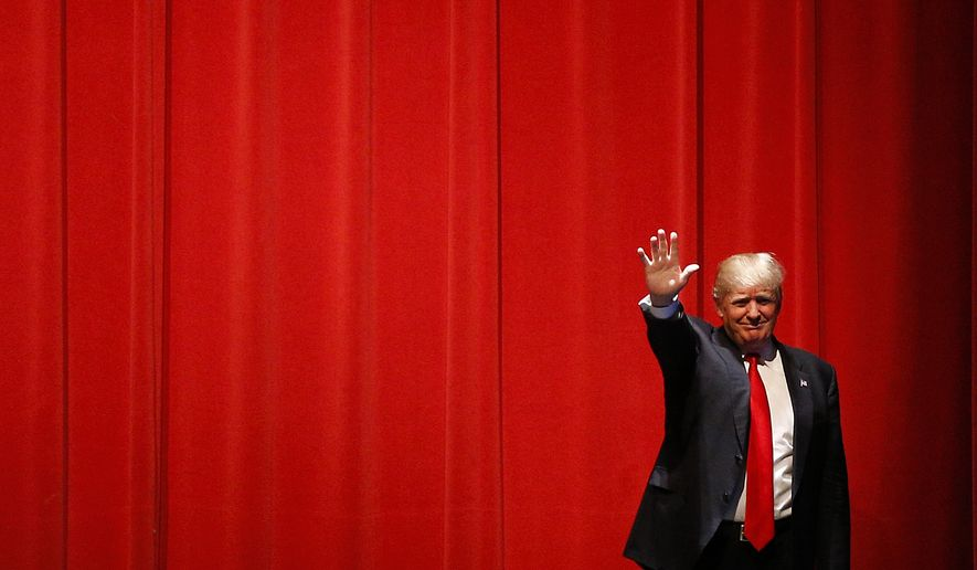 Republican presidential candidate Donald Trump waves as he walks onstage before speaking at a campaign event at St. Norbert College in De Pere, Wis., Wednesday, March 30, 2016. (AP Photo/Patrick Semansky)
