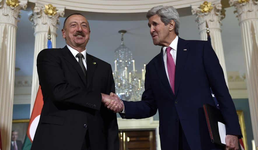 Secretary of State John Kerry shakes hands with Azerbaijani President Ilham Aliye after making statements before their meeting at the State Department in Washington, Wednesday, March 30, 2016. (AP Photo/Susan Walsh)