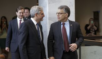 Judge Merrick Garland, left, President Barack Obama's choice to replace the late Justice Antonin Scalia on the Supreme Court, meets with Senate Judiciary Committee member Sen. Al Franken, D-Minn. on Capitol Hill in Washington, Wednesday, March 30, 2016.   (AP Photo/J. Scott Applewhite)