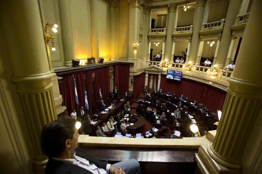 Lawmakers debate a deal with a group of U.S. creditors that would put an end to a years-long dispute that has kept the South American nation on the margins of international credit markets, in Buenos Aires, Argentina, Wednesday, March 30, 2016. If passed, Argentina would pay to resolve all related claims, including those from a group led by hedge fund manager Paul Singer's group in New York. The Senate was expected to vote late Wednesday or early Thursday. (AP Photo/Natacha Pisarenko)
