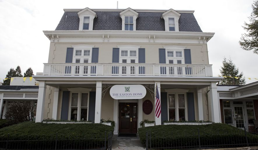 This Nov. 6, 2015, file photo shows The Easton Home, a senior living community, in Easton, Pa. Many relatives and friends providing financial support or care to people with dementia have dipped into their retirement savings, cut back on spending and sold assets to pay for expenses tied to the disease, according to a survey released Wednesday, March 30, 2015, by the Alzheimer's Association. (AP Photo/Matt Rourke, File)