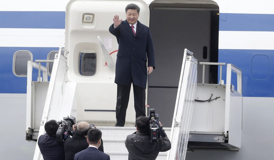 Chinese President Xi Jinping waves as he boards the plane at the airport to leave after his visit in Prague, Czech Republic, Wednesday, March 30, 2016. (AP Photo/Petr David Josek)