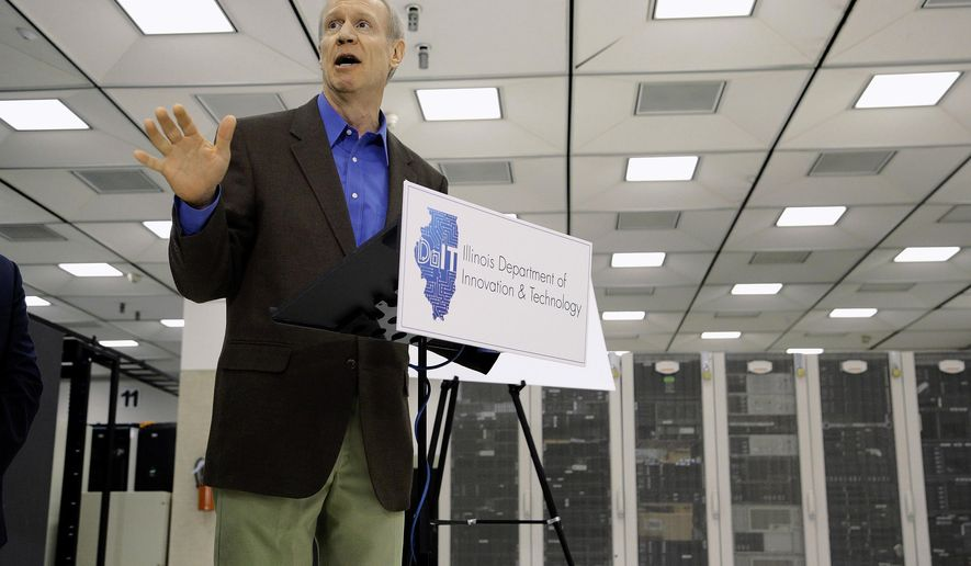 Illinois Gov. Bruce Rauner speaks to reporters on the Wednesday, March 30, 2016, at the State of Illinois Central Computing Facility in Springfield, Ill. Rauner accused Illinois Speaker of the House Michael Madigan, D-Chicago, and fellow Democrats of playing games by purposefully stalling on talks so they can make a case for a huge tax hike. (AP Photo/Seth Perlman)