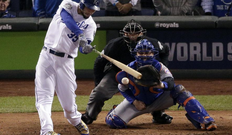 FILE - In this Oct. 28, 2015, file photo, Kansas City Royals' Eric Hosmer hits a two-run single against the New York Mets during the fifth inning of Game 2 of the baseball World Series in Kansas City, Mo. The Royals host the Mets on opening day of the 2016 season.  (AP Photo/Charlie Riedel, File)