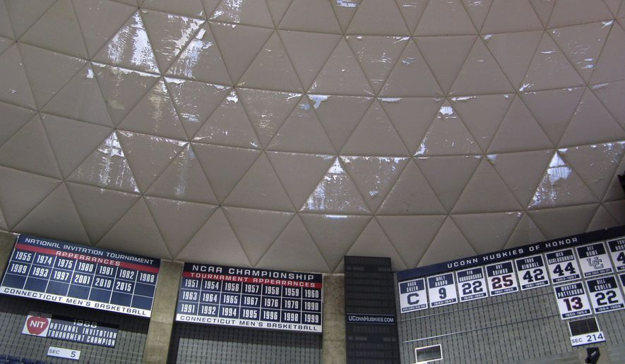 Numerous frayed panels hang in Gampel Pavilion, the University of Connecticut's basketball arena, Wednesday, March 30, 2016, in Storrs, Conn. The school's board of trustees approved plans to spend $10 million to refurbish the arena's aging roof, with work scheduled to be completed in October. (AP Photo/Pat Eaton-Robb)