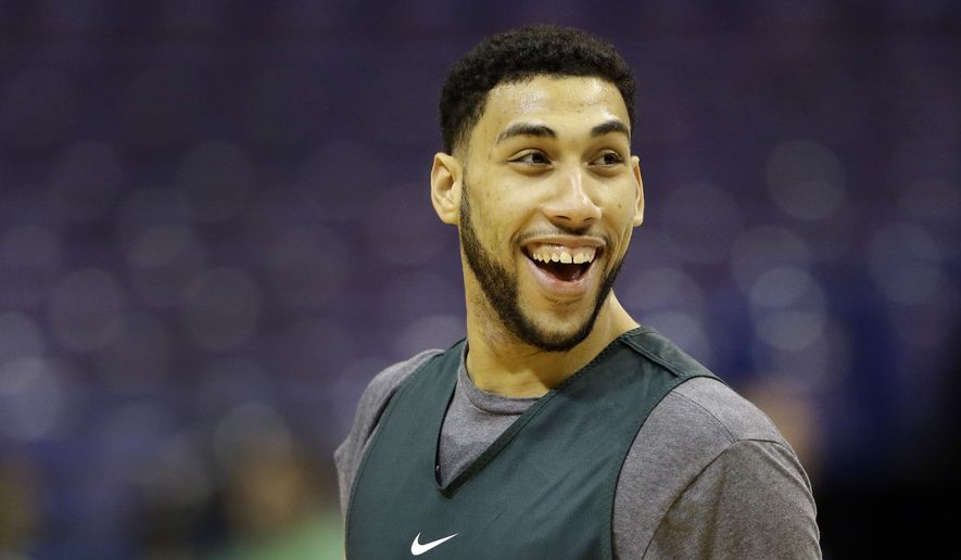Michigan State's Denzel Valentine laughs during practice ahead of a first-round men's college basketball game in the NCAA tournament, Thursday, March 17, 2016, in St. Louis. Michigan State plays Middle Tennessee on Friday. (AP Photo/Jeff Roberson)