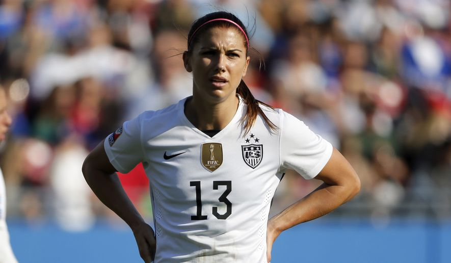 United States' Carli Lloyd (10) and Alex Morgan (13) wait for play to continue during a CONCACAF Olympic qualifying tournament soccer match against Mexico on Saturday, Feb. 13, 2016, in Frisco, Texas. (AP Photo/Tony Gutierrez)