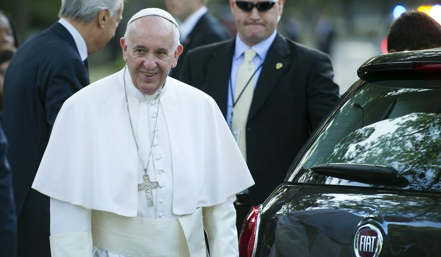 Pope Francis walks to his Fiat 500L to depart the Apostolic Nunciature, the Vatican's diplomatic mission in the heart of Washington, en route to the Capitol to address a joint meeting of Congress Thursday, Sept. 24, 2015.  (AP Photo/Cliff Owen)