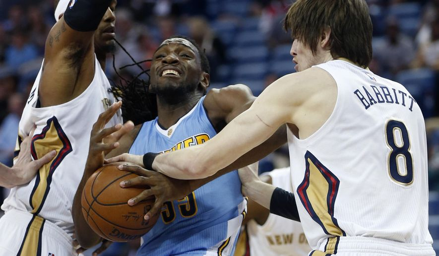 Denver Nuggets forward Kenneth Faried is stripped of the ball under the basket by New Orleans Pelicans forward Luke Babbitt (8) during the first half of an NBA basketball game in New Orleans, Thursday, March 31, 2016. (AP Photo/Gerald Herbert)