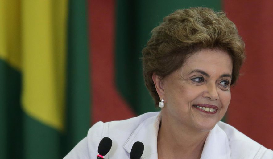 Brazil's President Dilma Rousseff smiles during the launching ceremony of the third stage of Minha Casa Minha Vida Program, at the Planalto Presidential Palace in Brasilia, Brazil, Wednesday, March 30, 2016. Former Brazilian President Luiz Inacio Lula da Silva said Monday that he believes Rousseff, his embattled successor and protege, can survive mounting pressure in Congress for her impeachment. Rousseff recently appointed Silva as her chief of staff in a much-discussed move that still must be confirmed by Brazil's top court. (AP Photo/Eraldo Peres)