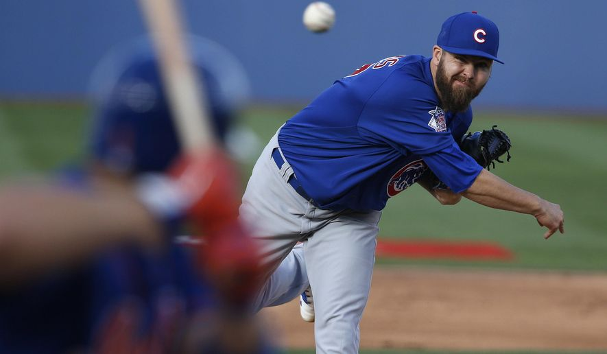 Chicago Cubs' Ryan Williams pitches against the New York Mets in the first inning of an exhibition baseball game Thursday, March 31, 2016, in Las Vegas. (AP Photo/John Locher)
