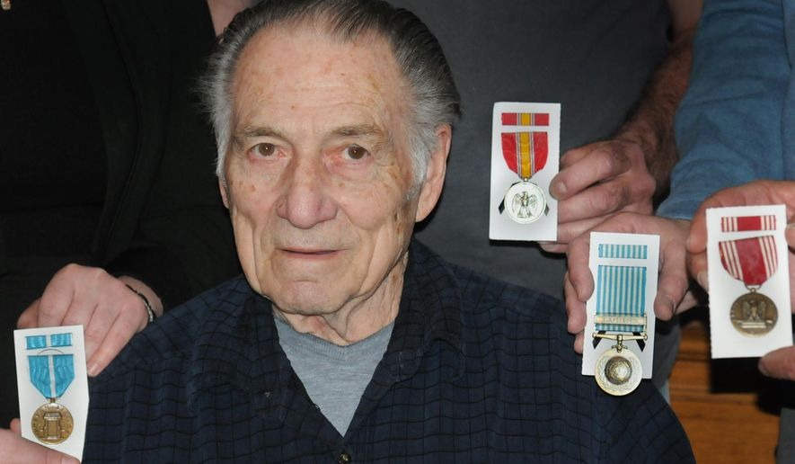 In this March 2016 photo, Korean War veteran Ronald G. DeBlase is presented four medals that he hadn't received from his service in the war about 60 years ago in Lower Pottsgrove, Pa. DeBlase says he didn't even know he'd earned the medals, which he received after a son's research and a congressman's help. (John Strickler/The  Mercury via AP)  PHILLY METRO OUT; MANDATORY CREDIT