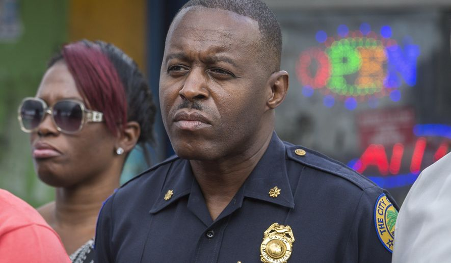 "In this Jan. 2, 2016, photo, Miami Police Maj. Delrish Moss stands among the Miami-Dade officials who announced the arrest of Willie ""Pee Wee"" Wilcher in Liberty City, Fla. Moss was announced as police chief in Ferguson, Mo., Thursday, March 31, 2016, putting a black man in charge of a mostly white department that serves a town where African-Americans make up two-thirds of the residents. (Matias J. Ocner/The Miami Herald via AP) MAGS OUT; MANDATORY CREDIT"
