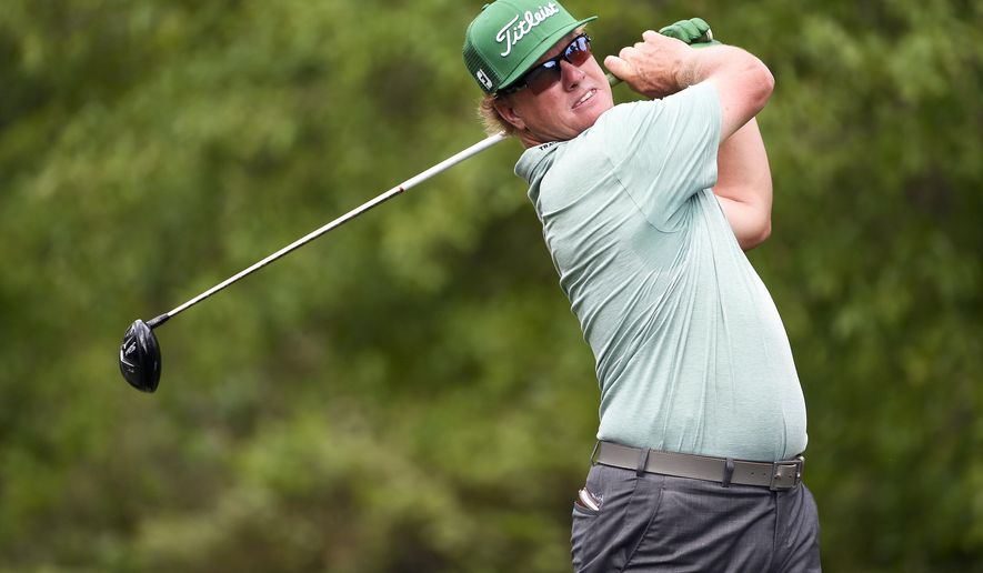 Charley Hoffman tees off on the second hole during the first round of the Houston Open golf tournament, Thursday, March 31, 2016, in Humble, Texas. (AP Photo/Eric Christian Smith)