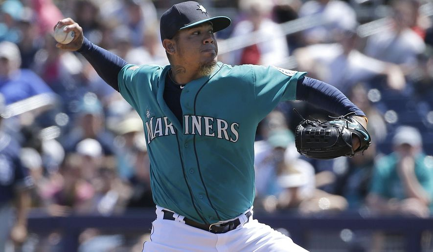 FILE - In this March 30, 2016, file photo, Seattle Mariners starting pitcher Felix Hernandez throws during a spring training baseball game against the San Diego Padres in Peoria, Ariz. Through all the various remodels over the course of too many lost seasons there have been two constants among Seattle baseball for the past decade: Felix Hernandez and missing the playoffs.   (AP Photo/Jeff Chiu, File)
