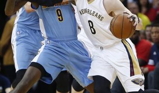 New Orleans Pelicans forward Luke Babbitt (8) works against Denver Nuggets guard JaKarr Sampson (9) during the first half of an NBA basketball game in New Orleans, Thursday, March 31, 2016. (AP Photo/Gerald Herbert)