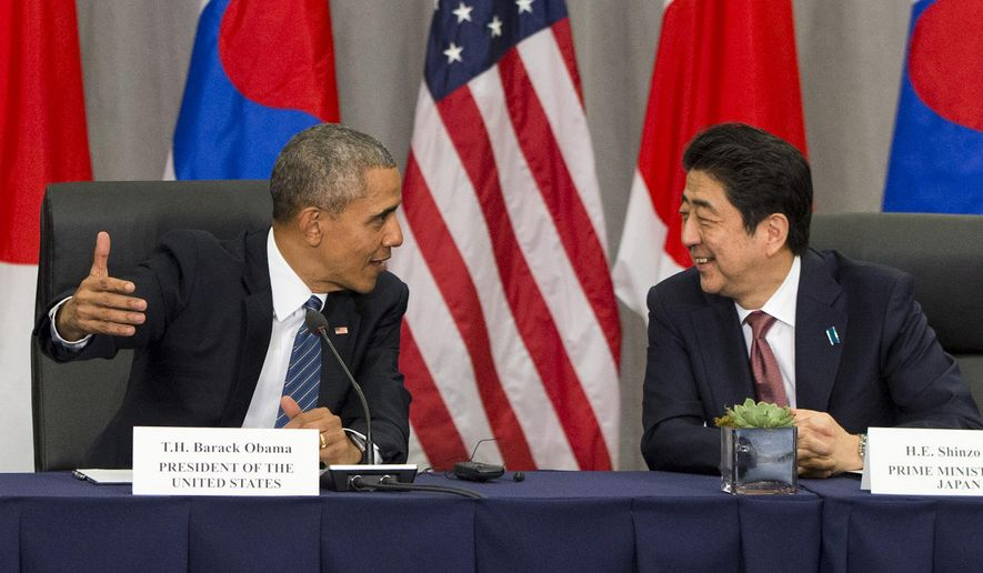 President Barack Obama speaks with Japanese Prime Minister Shinzo Abe during their meeting with South Korean President Park Geun-hye at the Nuclear Security Summit in Washington, Thursday, March 31, 2016. (AP Photo/Jacquelyn Martin)