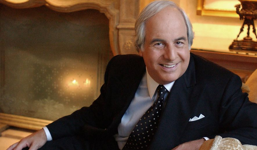 FILE - In this Dec. 16, 2002, file photograph, Frank Abagnale, Jr. poses for a photo at the Four Seasons Hotel in Beverly Hills, Calif. Abagnale, a con man turned security consultant,  has advised state governments to move cautiously when sending returns to taxpayers since fraudsters, many based outside of the United States, know that agencies cannot verify that all the returns are legitimate. (AP Photo/Lucy Nicholson, file)