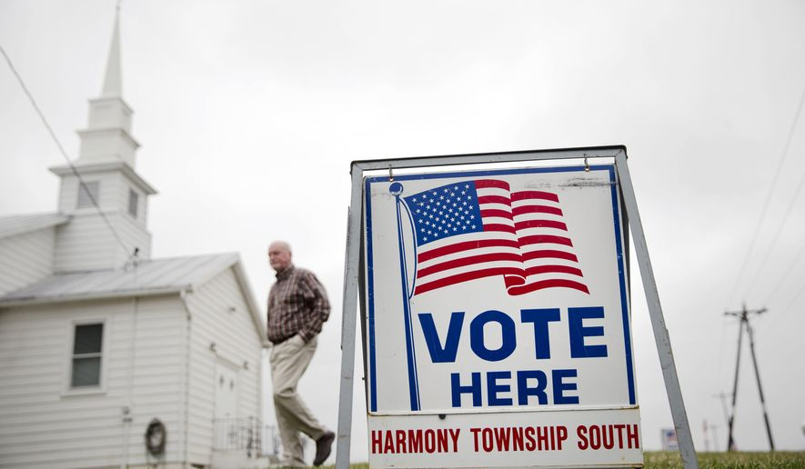 FILE - In this Tuesday, March 15, 2016 file photo, a voter walks to his polling place during the primary election at Harmony Chapel in Mt. Gilead, Ohio. A federal trial that could impact how thousands of certain ballots are cast and counted in swing state Ohio is winding down. At issue in the case are several changes to requirements for absentee or provisional ballots that the Republican-led state legislature passed in 2014. (AP Photo/Matt Rourke, File)