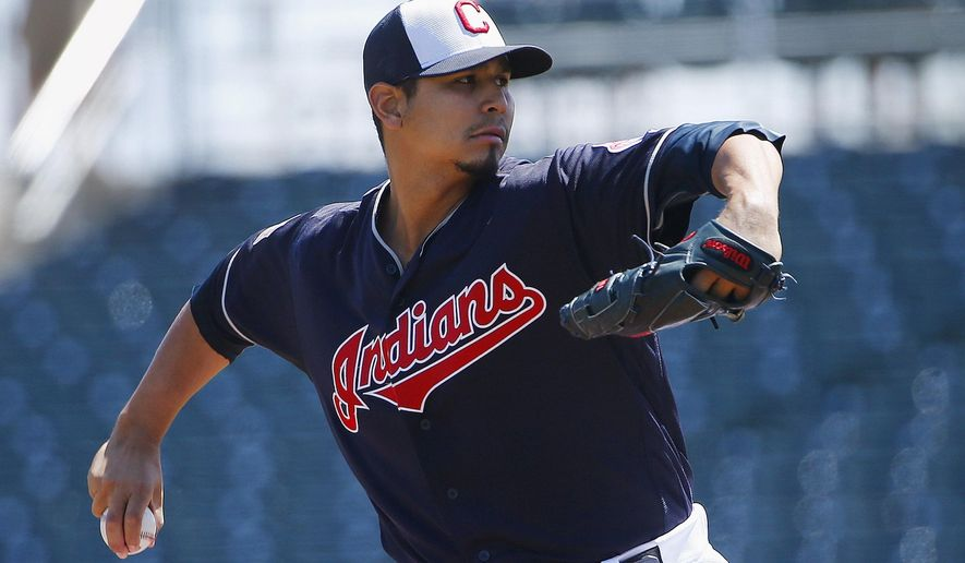 Cleveland Indians' Carlos Carrasco throws a pitch against the Cincinnati Reds during the first inning of a spring training baseball game Thursday, March 31, 2016, in Goodyear, Ariz. The Indians defeated the Reds 3-1. (AP Photo/Ross D. Franklin)