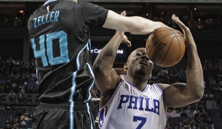 Charlotte Hornets' Cody Zeller (40) blocks a shot by Philadelphia 76ers' Carl Landry (7) during the first half of an NBA basketball game in Charlotte, N.C., Friday, April 1, 2016. (AP Photo/Chuck Burton)