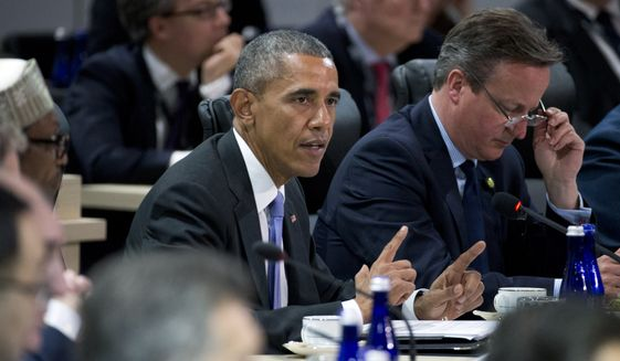 President Barack Obama, with British Prime Minister David Cameron, speaks during the afternoon plenary session of the Nuclear Security Summit, Friday, April 1, 2016, in Washington. (AP Photo/Alex Brandon)