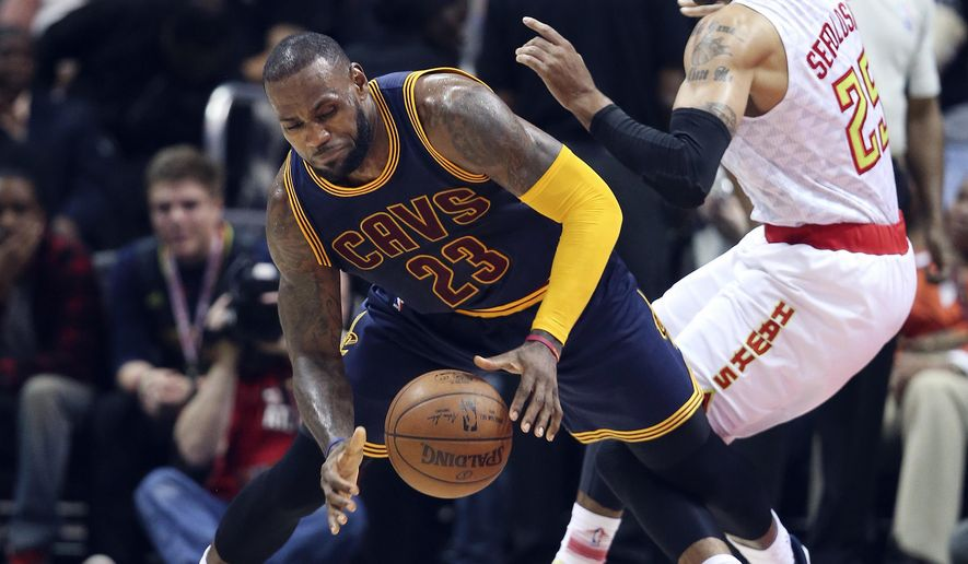 Cleveland Cavaliers forward LeBron James (23) slips as he works against Atlanta Hawks forward Thabo Sefolosha (25) during the first half of an NBA basketball game Friday, April 1, 2016, in Atlanta. (AP Photo/John Bazemore)