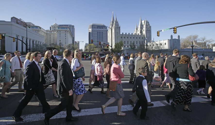 In this April 4, 2015, photo, people walk near the Salt Lake Temple on the way to the opening session of the Mormon Conference in Salt Lake City. Mormon leaders aren't expected to mention presidential candidates by name at this weekend's church conference, but they may reiterate their push for more public civility and compassion. The twice-a-year conference runs Saturday and Sunday in Salt Lake City. (AP Photo/Rick Bowmer, File)