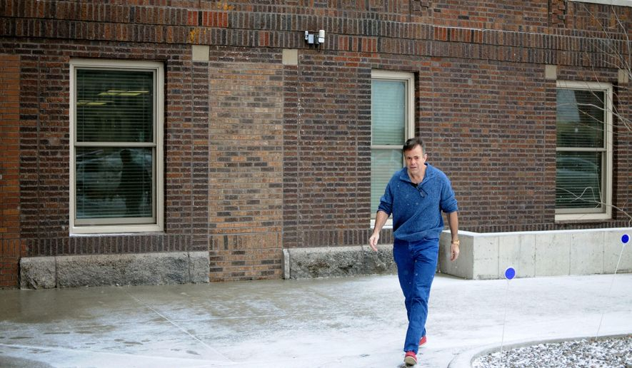 Joop Bollen, who faces felony charges stemming from an investigation into South Dakota's EB-5 visa program, walks to his initial court appearance in Aberdeen, S.D., Friday, April 1, 2016. (AP Photo/James Nord)