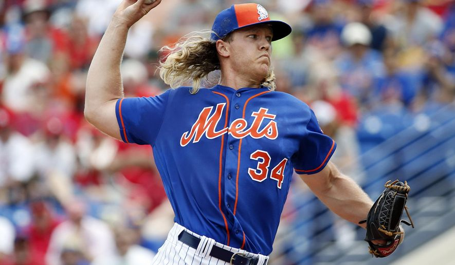 FILE - In this March 25, 2016, file photo, New York Mets' starting pitcher Noah Syndergaard throws during the first inning of an exhibition spring training baseball game against the St. Louis Cardinals in Port St. Lucie, Fla. New York's young fireballing rotation led the Mets back to the World Series at last. Syndergaard, Matt Harvey, Jacob deGrom, Steven Matz and Zack Wheeler are eager for an encore after missing a chance at a championship. (AP Photo/Brynn Anderson, File)