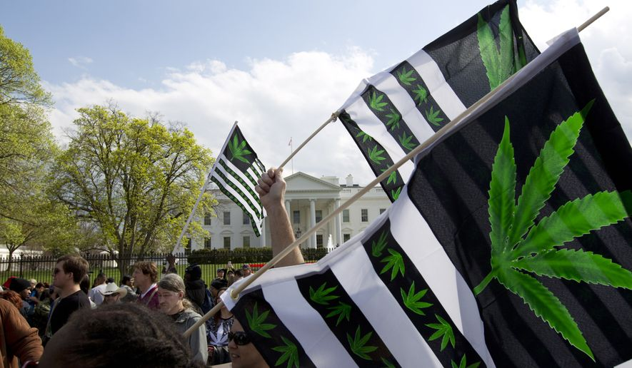 Demonstrators protest to legalize marijuana outside of the White House, in Washington, Saturday, April 2, 2016. During the event they demanded Obama use his authority to stop marijuana arrests and pardon offenders. (AP Photo/Jose Luis Magana)