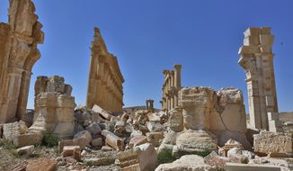 In this picture taken Friday, April 1, 2016, damage is seen in the ancient city of Palmyra in the central city of Homs, Syria. Explosions rocked the ancient town of Palmyra on Friday and on the horizon, black smoke wafted behind its majestic Roman ruins, as Syrian army experts carefully detonated hundreds of mines they say were planted by Islamic State militants before they fled the town. (AP Photo)