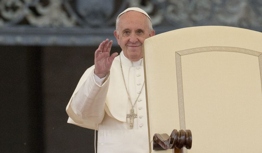 Pope Francis waves as he arrives to lead a Divine Mercy vigil prayer in St. Peter's Square at the Vatican, Saturday, April 2, 2016. (AP Photo/Alessandra Tarantino)