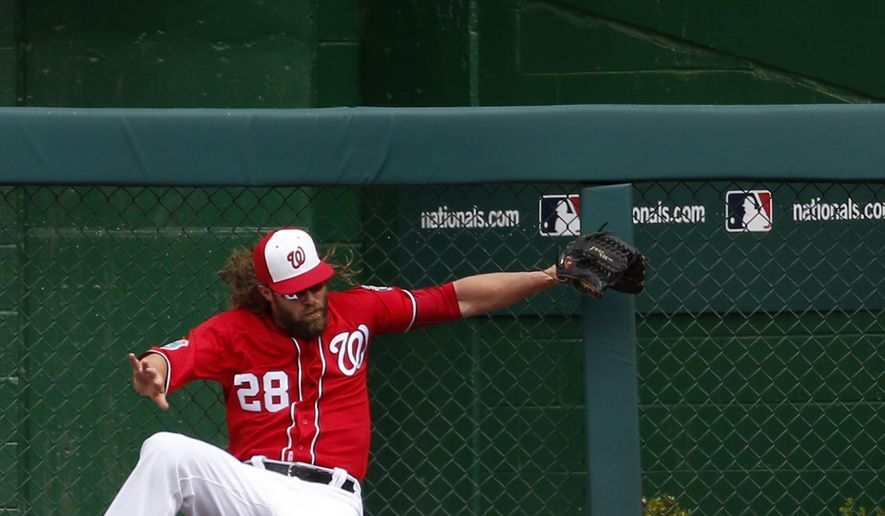 Washington Nationals left fielder Jayson Werth can't catch a solo home run by Minnesota Twins' Brian Dozier during the first inning of an exhibition baseball game at Nationals Park, Saturday, April 2, 2016, in Washington. (AP Photo/Alex Brandon)
