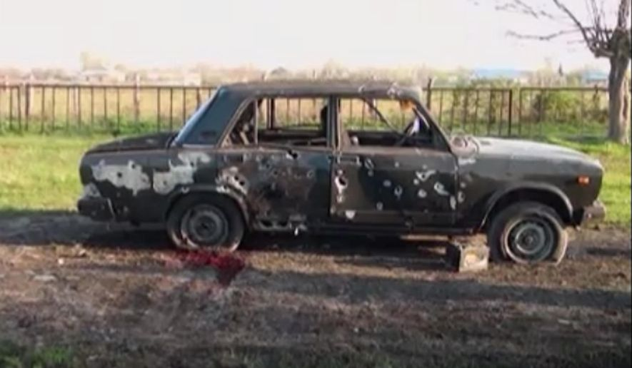 In this image from TV, a car destroyed with blood showing in the aftermath after heavy fighting erupted in Terter, Azerbaijan, Saturday April 2, 2016, between Armenian and Azerbaijani forces over the separatist region of Nagorno-Karabakh.  Russia expressed grave concern on Saturday over the recent military conflict along the Azerbaijan-Armenia border, calling on all parties involved to stop fighting and exercise restraint. Officials from each of the former Soviet republics blamed the other on Saturday for the fighting which began overnight. (Kanal S TV  via AP) TV OUT