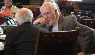 """File - In this March 21, 2016 photo, Kansas state Sen. Steve Fitzgerald, right, R-Leavenworth, confers with Sen. Rick Wilborn, R-McPherson, during a debate on a bill declaring that state Supreme Court justices can be impeached for attempting to """"usurp the power"""" of lawmakers and the executive branch, at the Statehouse in Topeka, Kan. Lawmakers in Kansas and Missouri have proposed expanding rules for impeaching judges. (AP Photo/John Hanna)"""