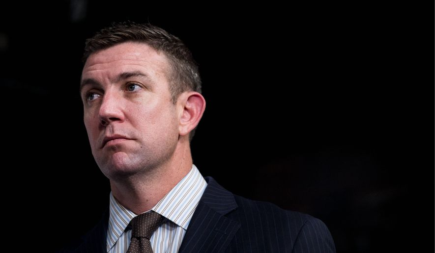 Rep. Duncan Hunter, California Republican, applauded the decision by the Army to reverse its discharge of  Sgt. First Class Charles Martland, for beating up an Afghan man accused of raping a 12-year-old boy.