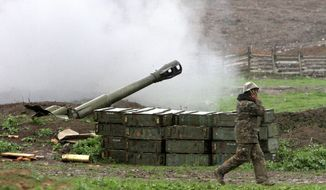 Flare up: Azerbaijan's Defense Ministry announced a unilateral cease-fire Sunday against the separatist region of Nagorno-Karabakh, but rebel forces said that they continued to come under fire. (Associated Press)