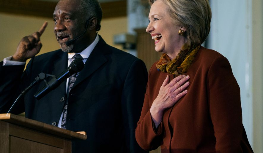 The Rev. Dr. Johnny Ray Youngblood speaks to congregants as he introduces Democratic presidential candidate Hillary Clinton at the Mount Pisgah Baptist Church in the Brooklyn borough of New York, Sunday, April 3, 2016. (AP Photo/Craig Ruttle)