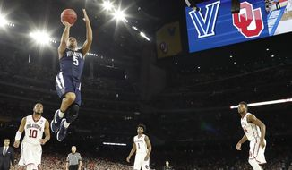Villanova guard Phil Booth (5) shoots ahead of Oklahoma guard Jordan Woodard (10) during the second half of the NCAA Final Four tournament college basketball semifinal game Saturday, April 2, 2016, in Houston. (AP Photo/David J. Phillip)