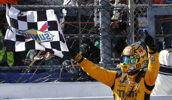 Kyle Busch celebrates winning the Sprint Cup auto race at Martinsville Speedway on Sunday, April 3, 2016, in Martinsville, Va. (AP Photo/Steve Helber)