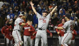 Washington Nationals starting pitcher Max Scherzer (31) celebrates his no hitter against the New York Mets with catcher Wilson Ramos (40), Dan Uggla (26), and teammates in the second baseball game of a doubleheader, Saturday, Oct. 3, 2015, in New York. The Nationals won 2-0. (AP Photo/Kathy Kmonicek)