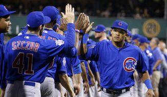 Chicago Cubs' Addison Russell, right, is introduced before the National League wild card game between the Pittsburgh Pirates and the Chicago Cubs at PNC Park Wednesday, Oct. 7, 2015 in Pittsburgh. (AP Photo/Gene J. Puskar)
